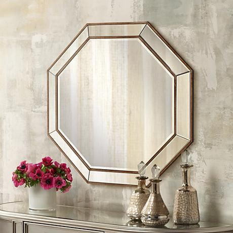 A visually striking beveled wall mirror in a unique octagon shape.