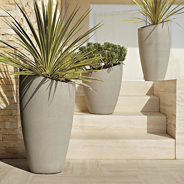 A slight slant to the rim trends these planters from the expected to the delightfully different. Statement pieces flank the door for a contemporary welcome or stage them together, short and tall, for a dynamic display of potted plants. Crafted of a lightweight combination of fiberglass, cement and sand that works indoors or out.<br /><br /><NEWTAG/><ul><li>Fiberglass, cement and sand</li><li>Drainage hole</li><li>For use indoors or out</li><li>Protect from freezing temperatures</li><li>Made…