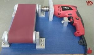 Drill Powered Belt Sander - Homemade drill powered belt sander constructed from surplus wooden boards, nuts, bolts, sandpaper, and a drill.