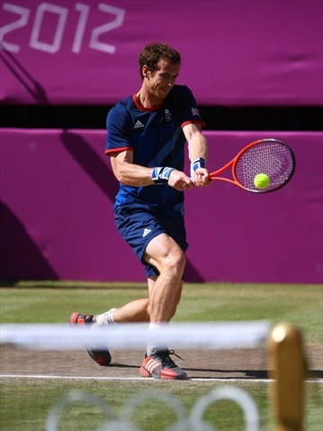 Andy Murray of Great Britain returns against Roger Federer of Switzerland during the men's Singles Tennis gold medal match on Day 9 at Wimbledon. Murray went on to win the match.