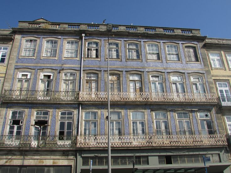 Building along the River Douro featuring blue and white tiles common to Porto #cathytravelling