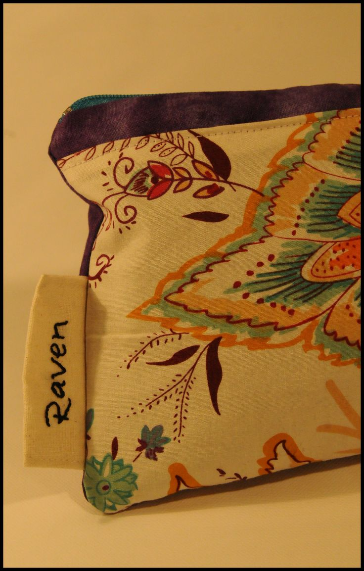 Custom made case for Raven. Her choice of fabrics, and also a hand embroidered name tag.