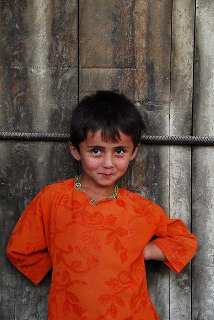 little girl in orange...