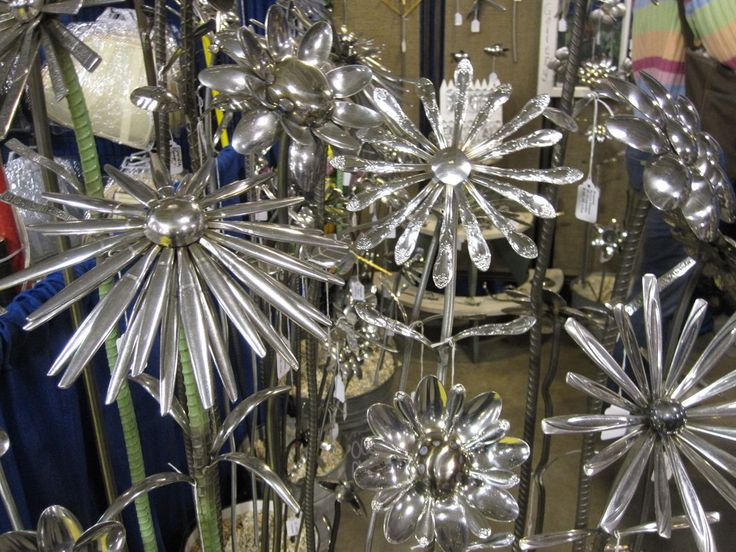 cool flowers to make for the garden from silverware--even 3 of these in a pot would be cute!