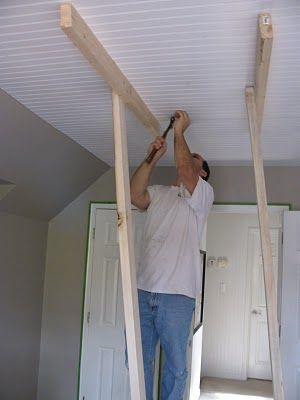 Beadboard ceiling - to cover the ugly popcorn ceiling. Hmmm. Only trouble is: very tall vaulted ceiling might be more difficult.