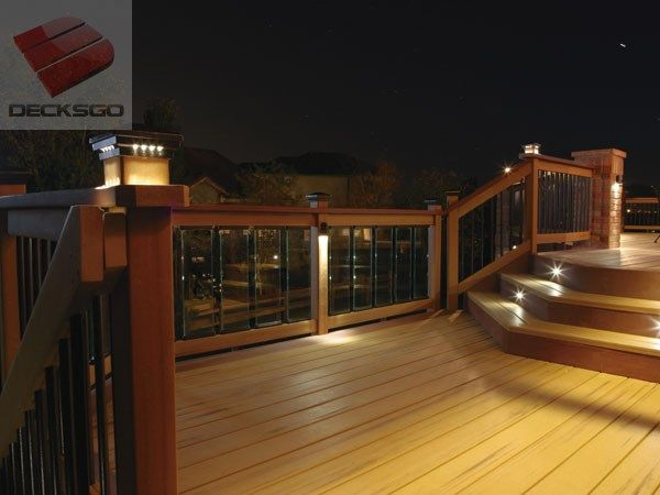 Dramatic evening ambience with lit post caps and glass panel balusters stair lightingoutdoor