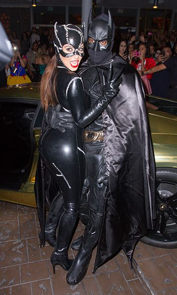 Kim Kardashian and Kanye West as Catwoman and Batman at Kim Kardashian's Halloween party in Miami Beach, Florida. | Billboard