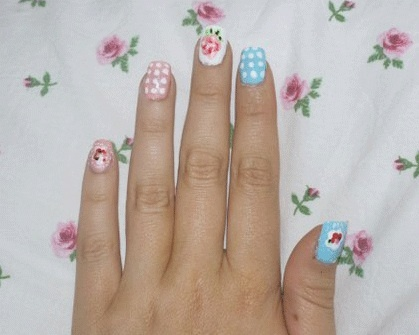 Nail Art We're Loving: Floral and polka dot mix 'n' match in pretty pastel shades by blogger Laura!