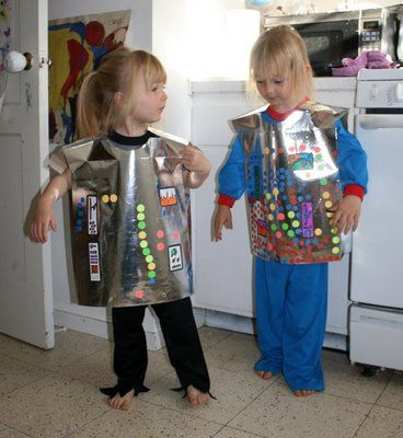 Dollar Store Crafts »  Robot costume silver using gift bags--  this would be super cute as a party activity
