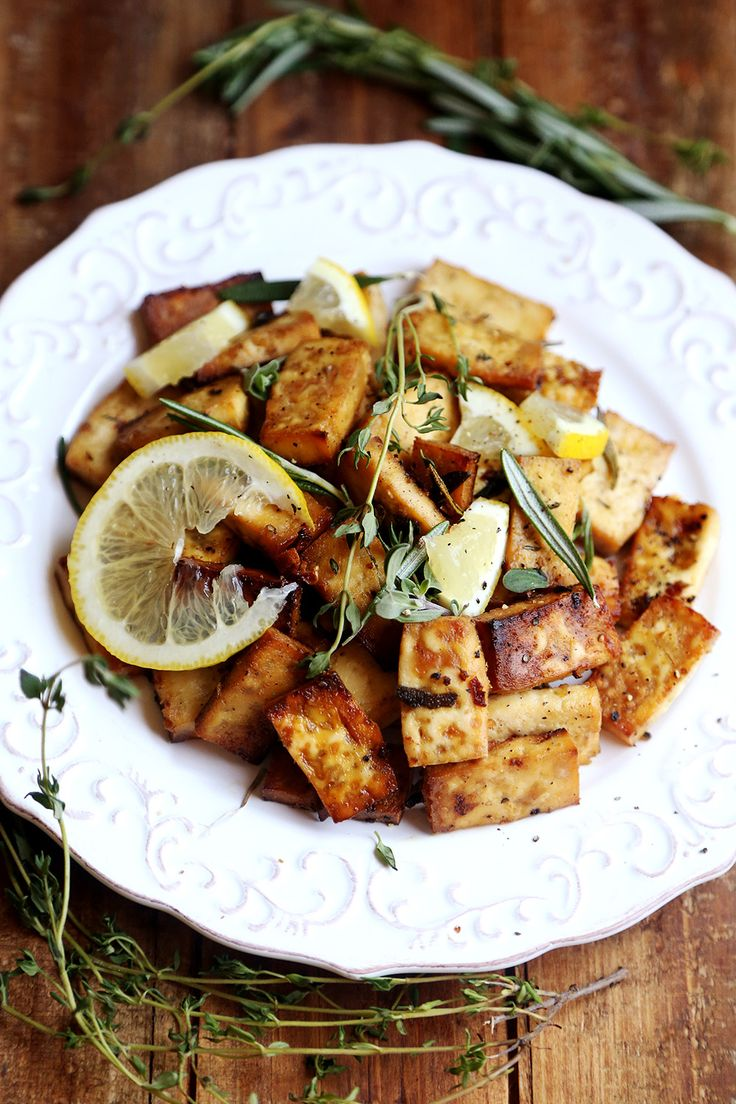 Lemon Herb Baked Tofu | Divine Healthy Food *halved the oil and used dried herbs instead of fresh. Still tasted really good. I opted to pan fry instead of baking.