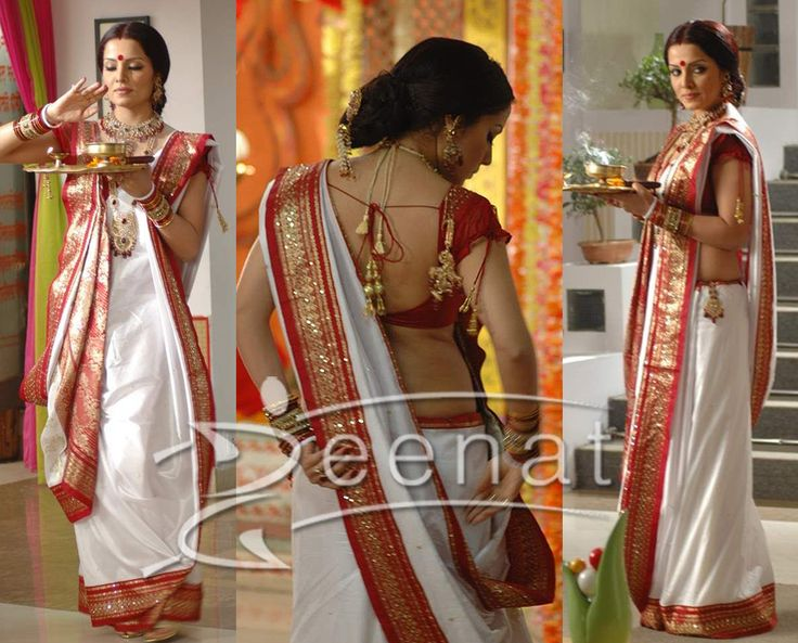 """@CelinaJaitly as a Bengali Bahu in beautiful #Saree, """"Her white pallu and borders are lined up with a very shiny and trendy red Gota Patti/Lace..and this comes with a Banarsi Blouse of stylish cuts and stich. Her blouse back is giving a trendy chic looks with studded Back Knots/Tie Trends."""""""