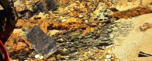 Handout photo shows some of the thousands of gold coins discovered on the SS Republic shipwreck site