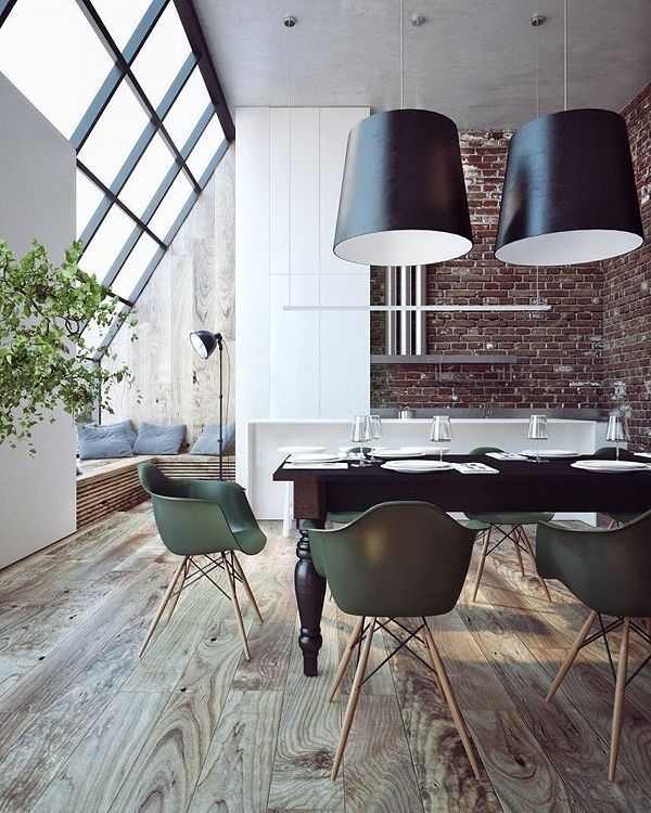 Neutral industrial with oversized lighting and green chairs // dining room