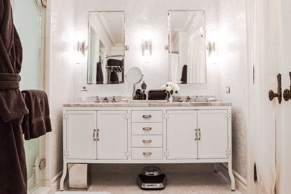 furniture decorative bathroom vanity bases white for vintage storage cabinet with victorian bow pull handles below roman tub waterfall faucet alongside standing makeup mirror