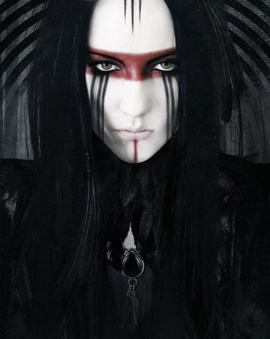 Gothic, black long hair, banshee brown band of shadow across eyes...