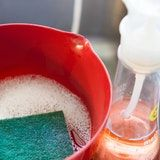 Combine a drop or two of dishwashing liquid with warm water in a bucket.