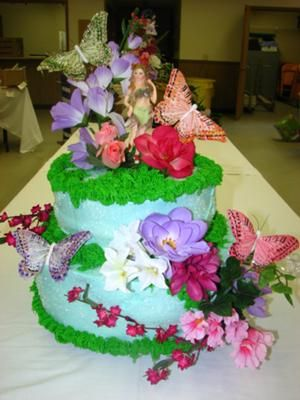 fairy garden i wanted to make a special cake for my sister actually for baby shower i used 2 layers 12 and each layer has 2 cakes with a cappuccino