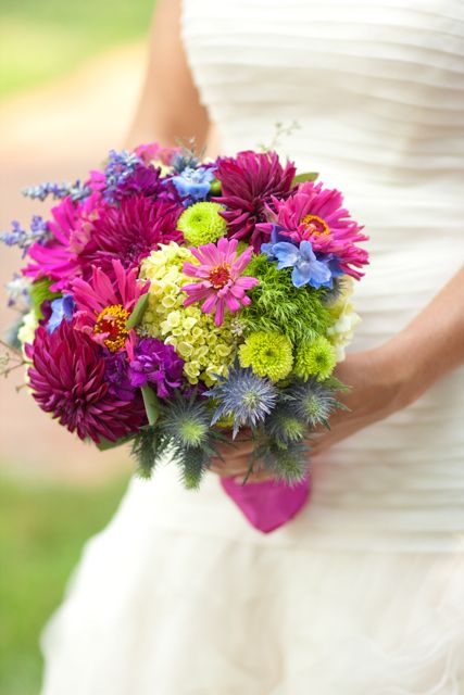 mini green hydrangea, green dianthus, green button mums, zinnia's from my garden, don'sdahlias, blue thistle, blue delphinium, blue salvia, and purple stock in the bouquet.