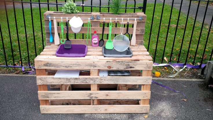 My mud kitchen! Made from pallets hanging bars from IKEA and utensils from Wilko.