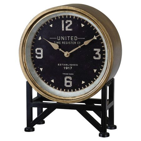 The perfect finishing touch for your office desk or living room mantel, this handsome table clock showcases a brass finish and an antiqued black stand.