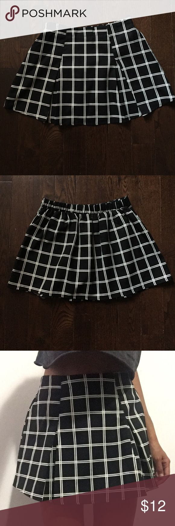 Black and white plaid pleated skirt Box pleated mink skirt with gathering at the back. Super cute schoolgirl style. Worn once. Forever 21 Skirts Mini