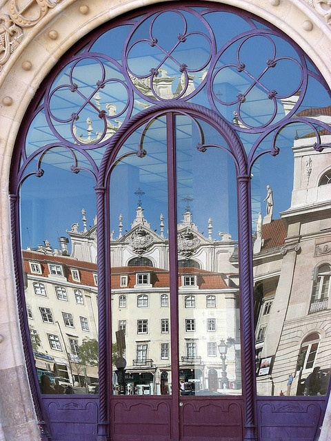 Reflection in the doors of the Rossio Station in Lisbon, Portugal