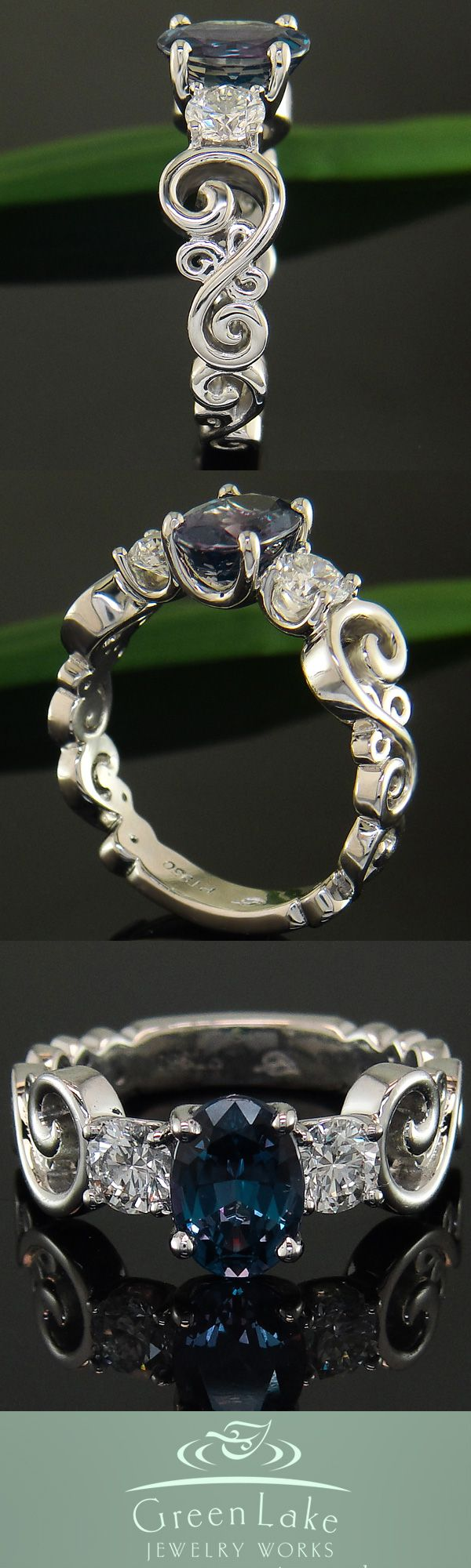 Swirl ring with alexandrite center and diamond accent gems.