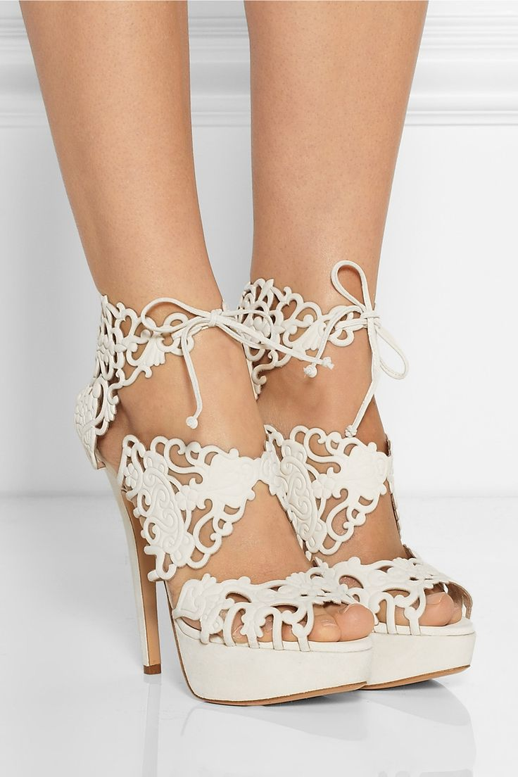 These are so fabulous...the cut out leather reminds us of lace. It would be fabulous to see these peeking out from beneath a wedding dress!  Charlotte Olympia|Belinda cutout suede sandals|NET-A-PORTER.COM