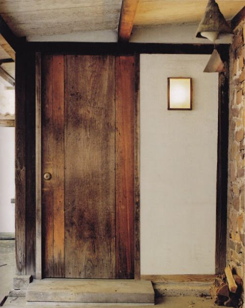 Door to George Nakashima's home, with a Paolo Soleri bell at the foreground. | via Handcrafted Modern by Leslie Williamson.