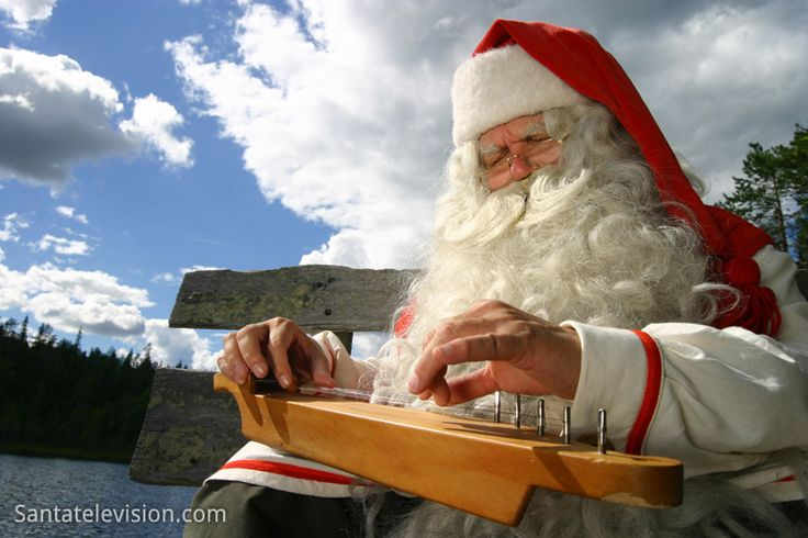 Santa Claus playing kantele in a summer day