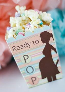 DIY baby shower decorations. I found this slightly funny as well as cute. Popcorn would be a nice light snack to serve at a baby shower.