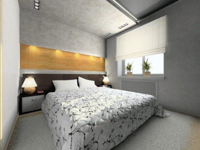 petite chambre en gris clair et blanc avec niche murale éclairée et deux tables de chevet en bois sombre