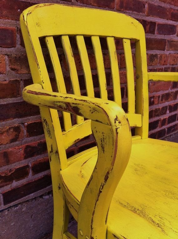 distressed armchair in sunny yellow