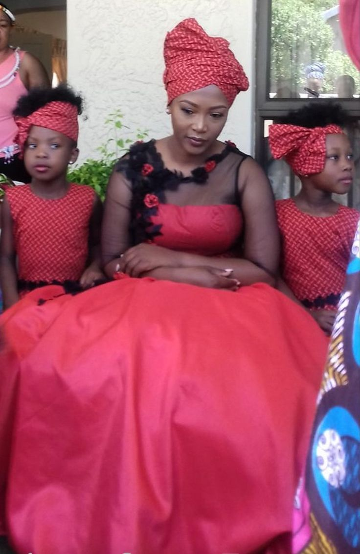 Mbali and her flower girls in red seshweshwe