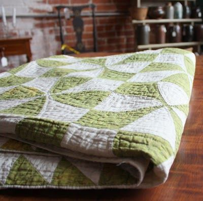 green and white antique quilt