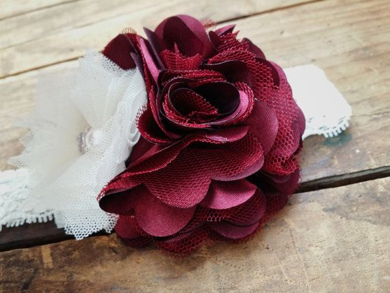 A vintage favorite that is the perfect accessorie for the fall on holiday season! This headband festures a deep maroon tulle and chiffon flower, paired with an ivory tulle flower with pearl and rhinestone accents. Featured on ivory lace elastic that is soft and stretchy. Flowers are backed with felt to ensure comfort for even the newest of baby girls. Makes the perfect gift!   Sizes: Newborn: 13 inches 0-3mo: 14 inches 3-6mo: 15 inches 6-12mo: 16 inches Toddler/Teen: 17 inches Adult:18 i...