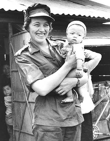 A Royal Australian Army Nursing Corps nurse and Vietnamese child, 1967.