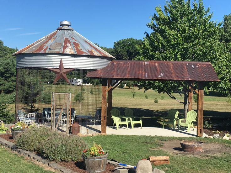 Repurposed corn crib and barn beam patio with corrugated ...