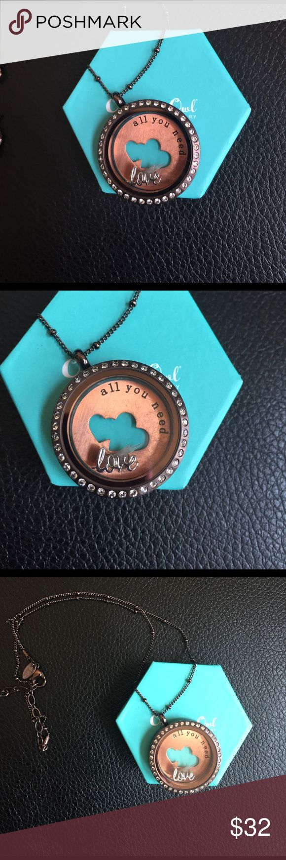 Origami Owl chocolate/rose gold/crystal necklace Very pretty Origami Owl limited quantity chocolate and crystal locket necklace with rose gold plate and love charm. Can remove inside pieces and put in other charms/plate unlimited ways to fill locket. Jewelry Necklaces