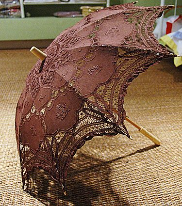 "Princess Anne Style. Battenburg lace parasol.Lace Parasol. (35 inches full open arc.) Brown color Parasol -   The Battenburg Lace Store, Inc.  A Fine Linens & Home Furnishings Place  - Only available in the 18""  $36.00 each"