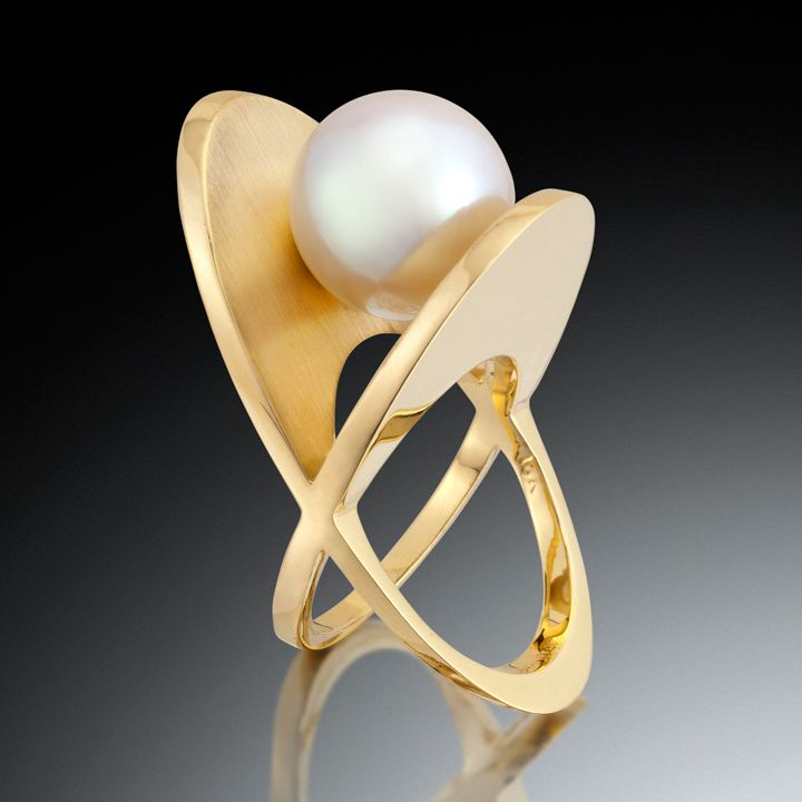 "Classical elements meet bold, sculptural lines. An exquisite ring. The XOXO ring features a 12mm AAA grade South Sea pearl rests between dynamic planes of 18kt yellow gold. To begin, please call (415) 262-9985 or click ""Inquire""."
