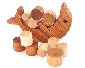 Wooden Balancing Toy - Montessori Wood Stacking Toy - Eco-Friendly Balancing Game - Waldorf Educational Toddler Toy - Dolphin (Cherry Wood). $39.00, via Etsy.