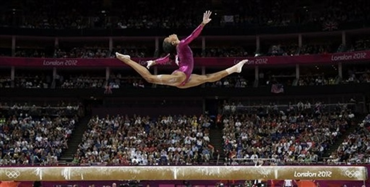 """Gabby Douglas: Women's All-Around Final - Gymnastics   Known as """"The Flying Squirrel,"""" Douglas won the women's all-around title Thursday night, becoming the third straight American to win gymnastics' biggest prize and the first African-American. It's her second gold medal of the London Games, coming two nights after she and her """"Fierce Five"""" teammates gave the United States its first Olympic title since 1996.: Olympic, Women S, Balance Beam, Gabby Douglas, Gabrielle Douglas, Gabbydouglas, Individual All Around, Photo, Gymnastics"""