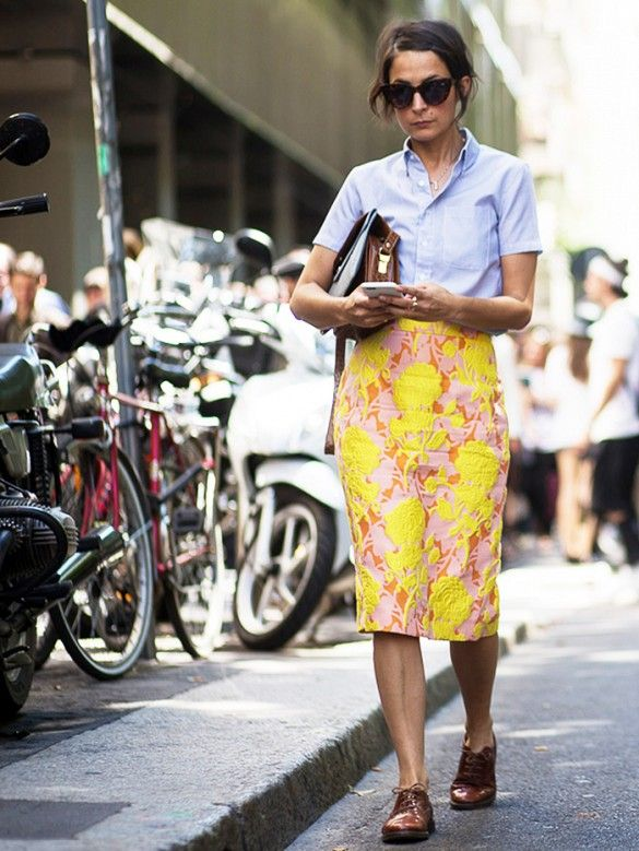 A short-sleeve button-down blouse is worn with a floral pencil skirt and patent oxfords