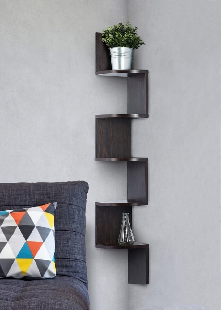 """Promising review: """"The shelves add an extra dimension of style to my room. They hold up well and are made of quality solid wood. They are great conversation starters and people praise me on the unique styling and look. The shipping was fast and I didn't have any problems whatsoever."""" —Sofia MozeniGet it from Amazon for $23.95 or a very similar one from Walmart for $24.92 and up."""
