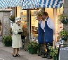 Queen chatting with local merchants