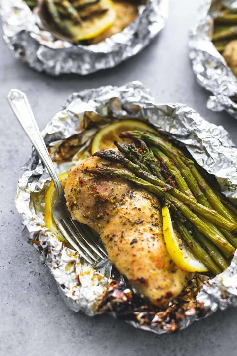 Lemon Chicken Asparagus Foil Packs: Grilled or baked, this no-stress foil pack meal will save you cleanup duty, too.