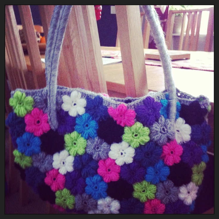 My newest bag made of crocheted flowers. I just love the colours and it was so much fun to do.