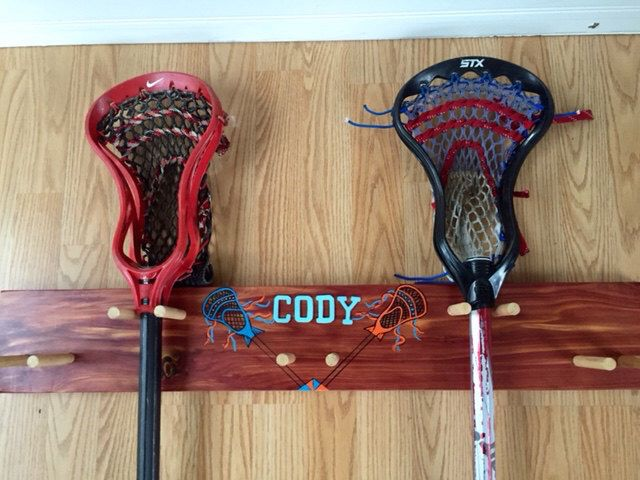 Lacrosse Stick Wood Rack, handcrafted and handpainted Virginia Red Cedar-Holds 4 Lacrosse Sticks, helmet by WindingRunCreations on Etsy https://www.etsy.com/listing/225069839/lacrosse-stick-wood-rack-handcrafted-and