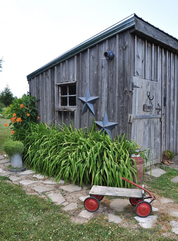 Weathered wood shed is part of this charming garden tour eclecticallyvintage.com